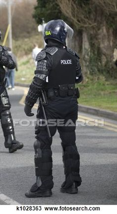 Uk Police Officers in Riot Gear. Uk police officers in full riot gear at the sce , Police Officer Uniform, Police Uniforms, Riot Police, Vintage Graphic Design, Gears, Royalty Free Stock Photos, Military, 2020 Vision, Helmets