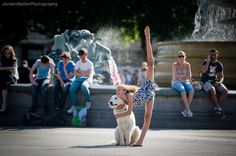 A girl's best friend! Kennedy Newell with the Marilyn Monroe of dogs, Marni, in Trafalgar Square, London.