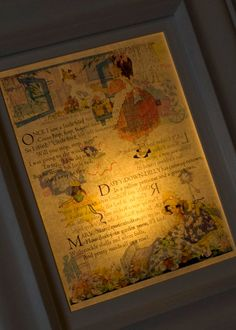 neat idea.    Decoupage a printed image (ie book page) to picture frame glass and string a light behind it.