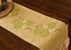 Elegant Table Runner, I have a ton of burlap, never thought of painting it but I am going to have to try this, minus the stencil, I like to free hand my stuff.
