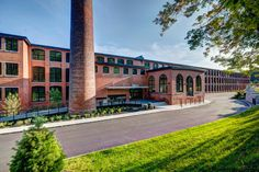 The thoughtful adaptive reuse and restoration of the historic building structure features 57 oversized, modern lofts market-rate units Massachusetts, Rive Nord, Adaptive Reuse, Listed Building, Modern Loft, Building Structure, Brick And Stone, Team Photos, It Works