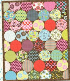 Featuring bright and beautiful circle cut quilt shapes, this quilt pattern uses a good variety of fabrics to create a unique look.