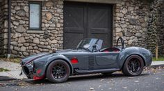 Immaculate Grey on red Shelby cobra