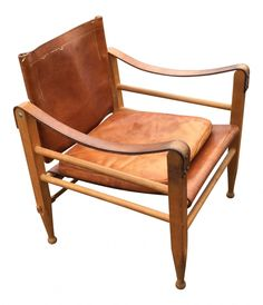 Vintage safari chair produced in Denmark in the 1970s. The style of the design has been attributed to Børge Mogensen. The chair is made from oak and leather and comes with a pillow. The leather is intact and the wood is in a good vintage condition.