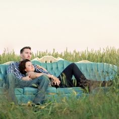 Romantic Ottawa Ontario engagement session with a big beautiful blue couch and warm sunlight all over.