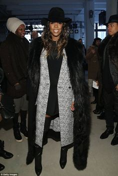 Going for drama: Kelly Rowland hit a fashion high note in her daring fur coat, thigh-high Christian Louboutins, and a classic LBD as she attended the Public School show at Made Fashion Week in New York