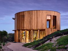 Situated on the coast of Victoria's Mornington Peninsula, the St Andrews Beach House breaks the beach shack mold with a curvy new exterior. Its timber-clad. Built In Furniture, Timber House, Beach Shack, St Andrews, Spiral Staircase, Metal Roof, White Walls, My House, Beach House