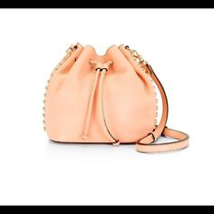 """New Rebecca minkoff unlined bucket bag❌trade Brand new with tag Come with original dust bag. 100% authentic  MSRP $325  Pebbled leather  9""""w*9h*5.75d Top handle with 4.5 """" drop  Adjustable and detachable shoulder strap 23.5"""" drop Custom light gold hardware❤️.                                           ♏er Cari $135 Rebecca Minkoff Bags Crossbody Bags"""