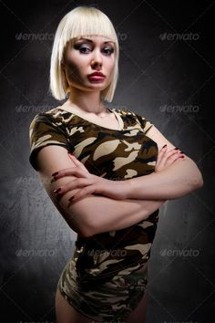 Military  young woman  with arms crossed ...  adult, aggression, angry, attractive, beautiful, beauty, blond, body, caucasian, clothing, confident, crossed, dangerous, emancipation, face, female, feminism, force, girl, green, hair, hands, isolated, lips, make up, makeup, military, model, panties, people, person, portrait, power, pretty, security, sensual, sensuality, serious, sexy, shorts, strong, uniform, white, woman, young