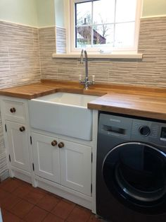 Simple yet effective...This  solid pine Belfast sink unit is painted in a lovely creamy 'wimbourne white' (F&B) and fitted with an oak worktop & upstand - which we wax to make  waterproof and durable, and fitted with matching wooden handles.As you can see we've left space here for the customers washing machine, but we can also hide them behind large double doors -whichever you prefer!