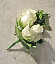 The mothers and grandmothers will wear corsages of ivory spray roses with seeded eucalyptus wrapped in raffia