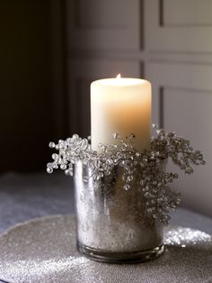 candle in mercury glass...surround with seasonal greens