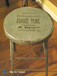 Industrial-style metal stool with a label design from the Graphics Fairy