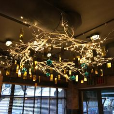 Large custom made wreath with white branches, gold leaves, glass balls and copper wire led lights.