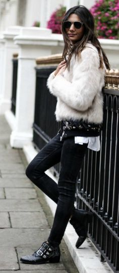 Federica L. + classic rocker girl style + cropped fur jacket + oozes edge + glamour + black jeans + leather boots + awesome style.   Jacket: H&M, Shirt: Jennyfer, Shoes: Bronx.