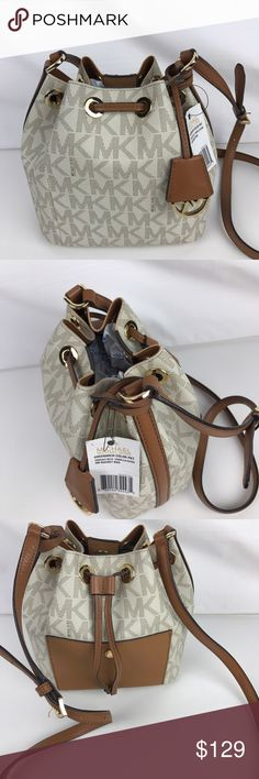 "Michael Kors Greenwich Small Bucket Bag Condition: Gently used. Good condition inside and out.  This season's most popular bucket bag comes finished in printed PVC with protective feet for extra sturdiness and style. Adjustable strap with 21""-24"" drop. Magnetic snap closure. 8-1/2"" X 7-1/2""X 4"" D. Style 30H5GG1M1V. Our bag # RB223  Thank you for your interest!  PLEASE - NO TRADES / NO LOW BALL OFFERS Michael Kors Bags Crossbody Bags"