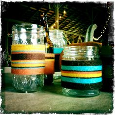 wrapping glass bottles with yarn....i thought we could do this with more christmas-y colors.  if anyone has glass bottles/jars/beer/wine bottles in their recycling or sitting around their house, please bring them!