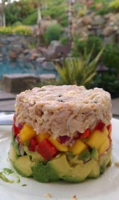 Crab Avocado Mango Stack from Food.com:   								This is one of my favorite appetizers at a local seafood restaurant.  I loved it so much that I've recreated it at home.  It makes enough for two generously portioned stacks.
