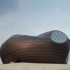 Here's another image captured by @raphael_olivier in Ordos the largest Chinese ghost town. Shaped like a large undulating blob the Ordos Museum by Beijing studio MAD is clad in polished metal tiles that are resistant to sandstorms.  We're posting three of the most popular photography projects from the pages of Dezeen for today's Instagram roundup but if you want to see even more stunning architectural images visit our dedicated archive on http://ift.tt/1JSL8bn #China #Ordos #photography…