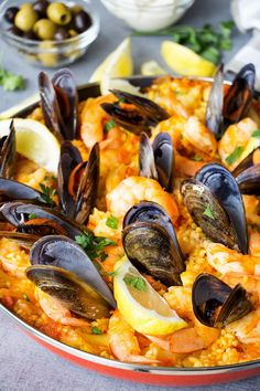This Spanish Seafood Paella features a crusty saffron and veggie infused layer of rice topped with squid, mussels, and shrimp. The best seafood dish ever! Fish Recipes, Seafood Recipes, Cooking Recipes, Healthy Recipes, Seafood Paella Recipe, Best Paella Recipe, Spanish Seafood Rice Recipe, Seafood Boil, Gourmet