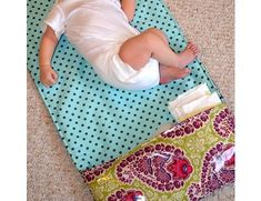 TUTORIAL: Diaper changing mat that rolls up into a handy clutch.