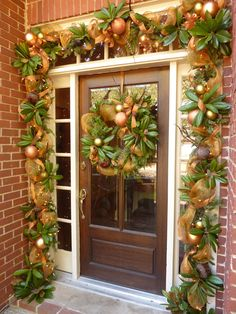 with Magnolia leaves. Christmas Front Doors, Christmas Porch, Christmas Mantels, Christmas Holidays, Christmas Wreaths, Southern Christmas, Christmas Decorations For The Home, Fall Home Decor, Xmas Decorations