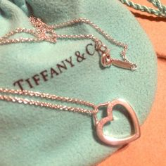 "AUTHENTIC T&Co small open heart pendant 16"" .925 Gorgeous dainty open heart pendant charm necklace. 100% authentic. 16"" chain. Excellent condition. Comes with original pouch. Tiffany & Co. Jewelry"