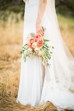 Spring brides must see! This earthy romantic wedding is truly unreal and stunningly beautiful. The wedding colors; taupe, ivory, green and a pop of peach are grougeous and show off the beauty of SoCal nature. The bride's veil is a dream. This is a beautiful anniversary photoshoot and a spring wedding inspiration! Katrina Jayne Photography. This is a must see! #springwedding #weddinginspiration #anniversary #coupleportraits #weddinggoals #spring #westlakevillage #socalweddings #bridegroom
