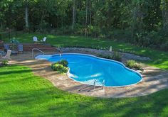 This mountain pond shaped pool really added a tropical for Pool design rochester ny