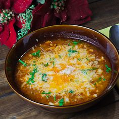 LASAGNA SOUP  2 tsp olive oil  1 lb ground pork  1 large onion, chopped  6 garlic cloves, minced  2 tsp dried oregano  1/2 tsp crushed red pepper flakes  3 tbsp tomato paste  1 14 oz can diced tomatoes  2 bay leaves  6 to 8 cups water  8 oz mafalda pasta  1 tbsp dried basil, or 1/4 cup fresh basil, chopped  salt and pepper to taste  mozzarella and Parmesan cheese for sprinkling on top of soup