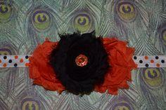 orange and brown shabby with orange diamond embellishment on a polka dot headband on Etsy, $8.50