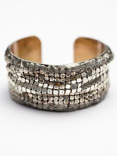I like cuff bracelets - they kind of have the same feel/style as bangles, but they don't make noise and are easier/quicker to take off when working at a desk. I like the brass tone of this one. It seems really versatile.
