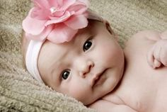 This site gives directions for making your own baby headbands...so cute!