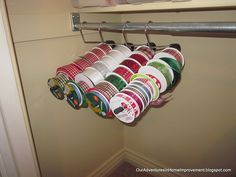 Our Adventures in Home Improvement: Super Easy Ribbon Storage. Ribbon on pant hanger