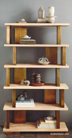 The rich, golden feel of antiqued brass is enchanting in combination with natural, elm wood. Kiln-dried, solid wood shelves are sand-blasted to accentuate the wood grain. Blocks encased in fine brass foil serve as shelf risers. Over-sized, exposed brass screws hold the shelves solidly in place while adding visual appeal.