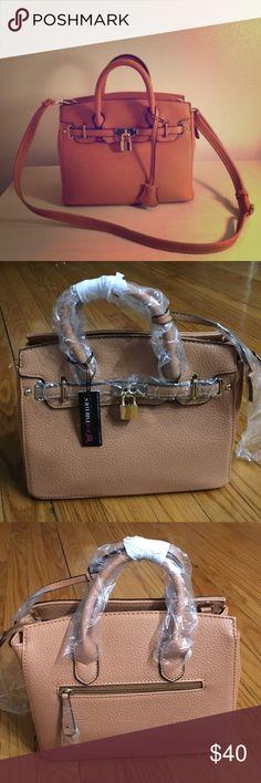 Just fab petite icon nude bag brand new Brand new just fab bag. No trades. Mini icon. JustFab Bags Mini Bags