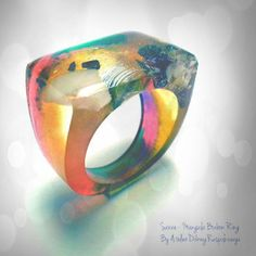 Check out this item in my Etsy shop https://www.etsy.com/listing/213025930/the-sunset-multicolor-bonbon-resin-ring