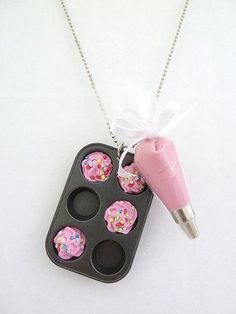 Cupcakes Take The Cake: Cupcake jewelry cuteness alert: Mini cupcake baking pan and frosting piping bag necklace- Tap the link now to see our super collection of accessories made just for you! Cute Jewelry, Jewelry Accessories, Jewelry Necklaces, Unique Jewelry, Jewlery, Fashion Accessories, Crea Fimo, Fake Cupcakes, Cute Necklace