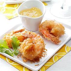 Quick Coconut Shrimp Recipe -These coconut-fried shrimp are downright addicting. If you ask me, the bigger the shrimp, the better. That way you can pick up even more of that sweet pina colada sauce. —Debbi Barate, Seward, Pennsylvania