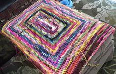 Rectangular granny afghan, crocheted with scrap sock yarn. In progress.