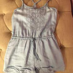 American Rag Jean Romper Light jean romper with braided straps that create a T-strap back. Worn twice. Still in condition as originally bought. American Rag Pants Jumpsuits & Rompers