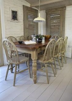 We've painted this large dining set in Annie Sloan Country Grey over Old White, creating a charming rustic farmhouse look. There's plenty of room for all the family with 8 wheelback chairs and large table top by victoria