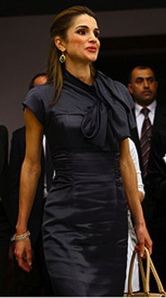 Queen Rania Al-Abdullah. BEAUTIFUL dress. Paired well with mustard bag and red lipstick. Hair style - in a clip. Love.