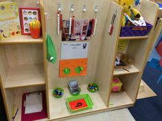 Maths shelf. Shelf is empty because activity is on rug!