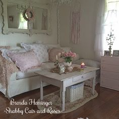 Love the white woven storage basket under the cute painted white coffee table !
