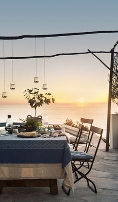 Who wouldn't be seduced by images of dining at sunset, looking out over the sea? Or the vision of a comfy, cushion laden outdoor bed, complete with wafting curtains. H & M Home, Summer Party Themes, Outdoor Dining, Outdoor Decor, Outdoor Rooms, Seaside Decor, House By The Sea, Backyard, Patio
