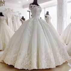 This ball gown style wedding dress has a pretty sheer illusion neckline.  Custom #weddingdresses can be made for less here.  We also specialize in #replicas of couture designer #dresses.  So if your dream dress is out of your price range we can help.  DariusCordell.com