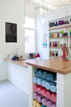 Good storage ideas for products + reception colours are ace