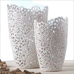 Two's Company White Lace Vases: White lace cutwork ceramic makes up these fashionable vases from Two's Company.  Smaller is 7 1/4