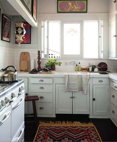 I like how cozy this kitchen feels.  I also like all the wall space where you could put shelves or artwork.
